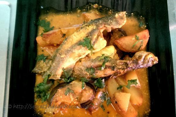 photo of begun tangra (brinjal and tangra fish curry)
