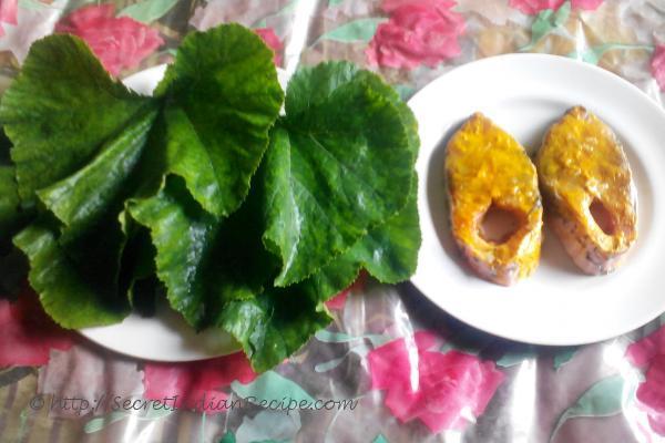 photo of raw fish and Pumpkin leaf