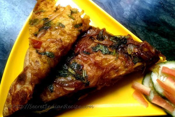 photo of pyazi masala paratha (onion stuffed flat bread)