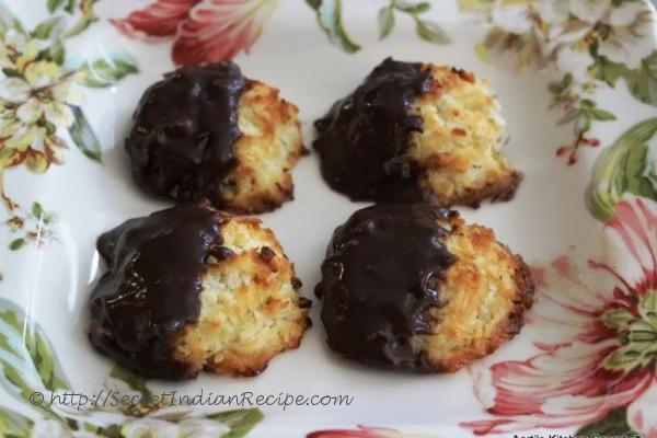 photo of chocolate dipped eggless coconut macaroons with cardamom flavour