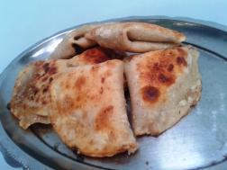 Manda (Sweetende Puffed rice powder stuffed in all-purpose flour )
