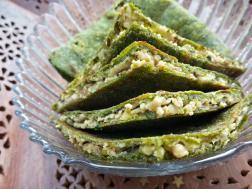 photo of palak paneer paratha (spinach cottage cheese stuffed indian bread)
