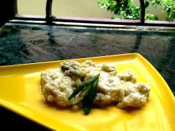 photo of chena bhape (steamed cottage cheese in coconut and mustard gravy)