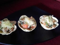 photo of baked tacos with veggi topping