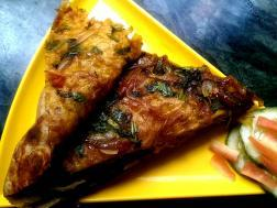 photo of pyazi masala paratha (onion stuffed flat bread)
