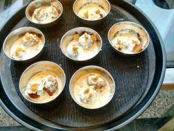 photo of gulgule / pua in rabdi ( sweet dumplings in densed condensed milk)