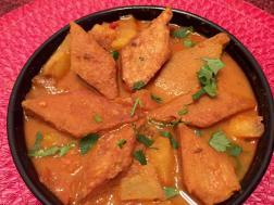 photo of dhokar dalna (fried lentil cakes in bengali curry)