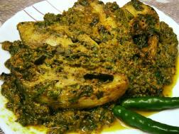photo of steamed hilsha with shredded ash gourd leaf