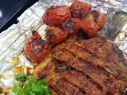 photo of baked karimeen (pearl spot)