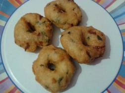 Methu Vada with Pepper and coriander leaves